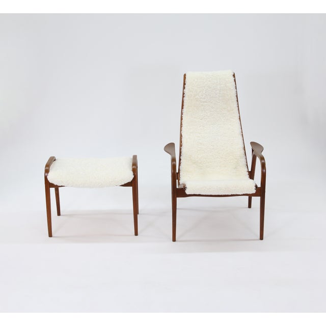 This is a vintage Lamino model easy chair and ottoman, designed by Yngve Ekström for Swedese. This is an early version of...