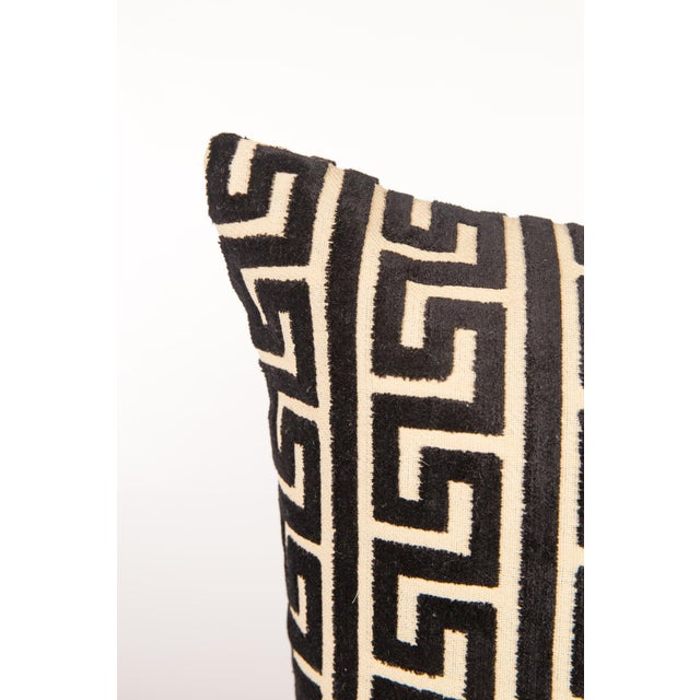 Pair of custom black-and-ivory cut velvet Greek key pattern throw pillows with pattern on fronts and backs. Knife-edge...