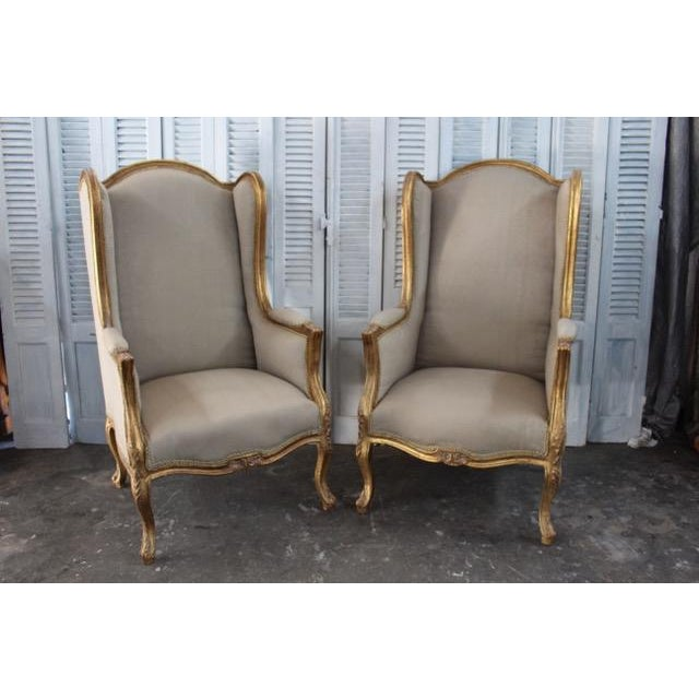 Louis XV style bergère chairs made of solid walnut and complete with a cotton upholstery with double welt trim. Beautiful,...