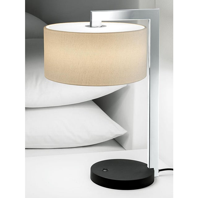 A deco style satin black bronze with polished chrome table lamp with shade. Designed with a rectangular tube section which...