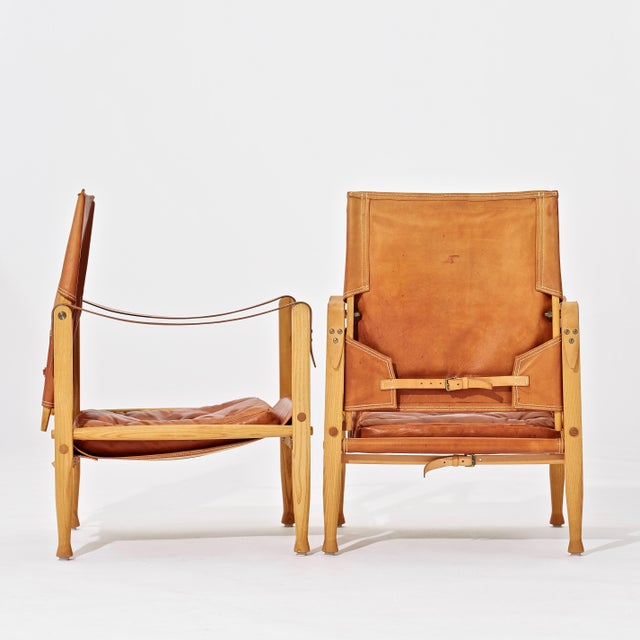Rud Rasmussen A Pair of Kaare Klint Safari Chairs and Ottomans, Rud Rasmussen, Denmark, 1960s For Sale - Image 4 of 6