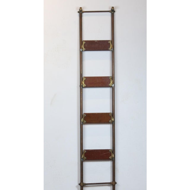 English brass library ladder. The steps are mahogany with rubber and they fold.