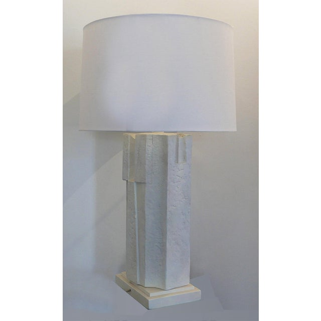 A Brutalist column table lamp. It is on a wood base. New linen shade (can be purchased additionally) and white wood ball...