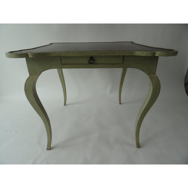 Minton-Spidell game table with drawer. Tooled leather with nailheads on tabletop.