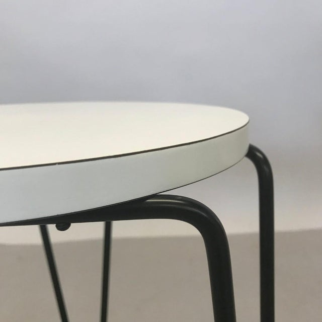 Classic three-legged stool or side table designed by Florence Knoll and manufactured by Knoll in the mid 20th century....