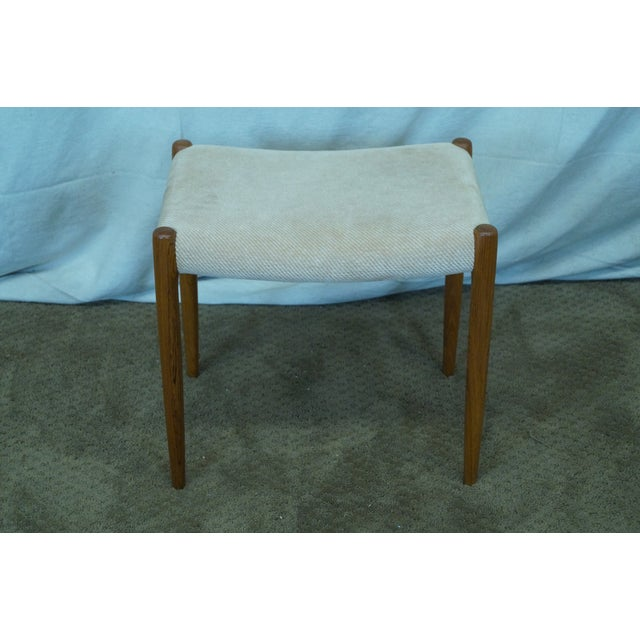 JL Moller Hojbjerg Danish Modern vintage teak bench with upholstered seat. Approximately 30 years old and from Denmark.