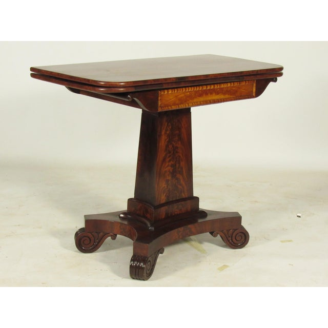 An early 19th-C. American Classical crotch mahogany pedestal base card table, attributed to 19th-C. Boston furniture maker...