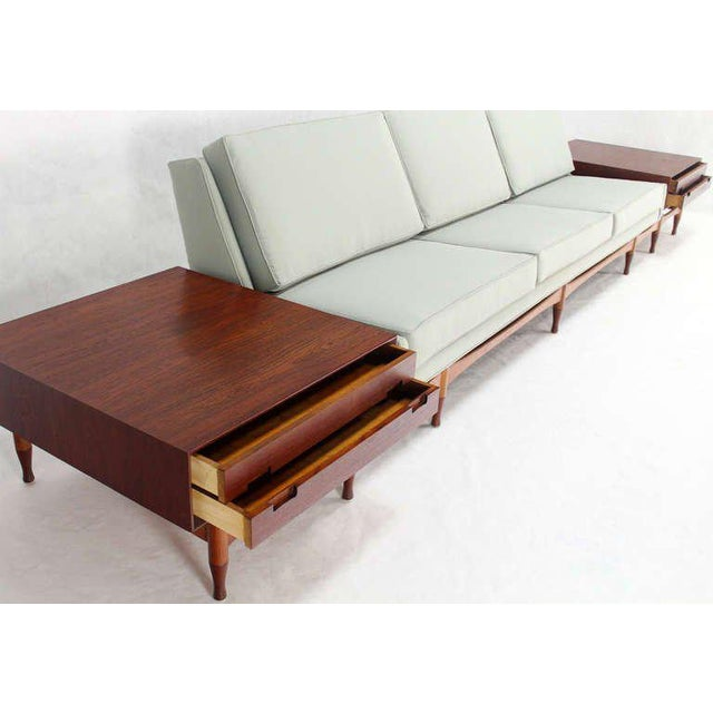 "New Upholstery, unusual extra long mid century modern sofa with built in end tables. The sofa alone measure 109"" long"