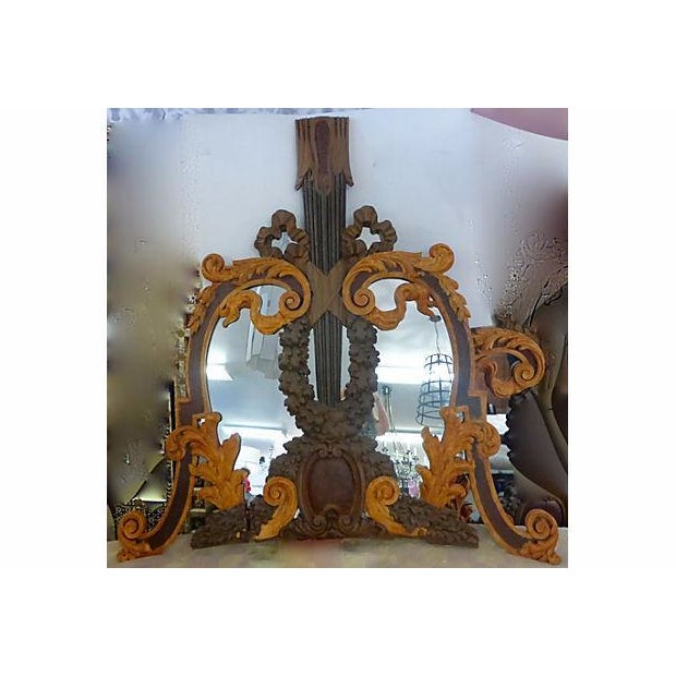 These are two stunning antique mirrors from Italy. Hand carved wood frames to resemble a 'tree' with a large carved trunk....