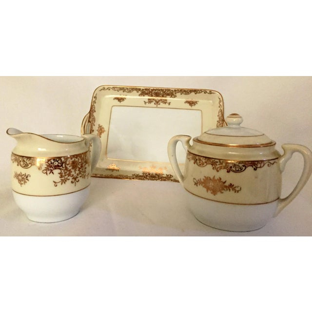 This is a lovely set to grace your dining table. 3 piece Noritake Sugar and Creamer. Hand Painted. Excellent condition....