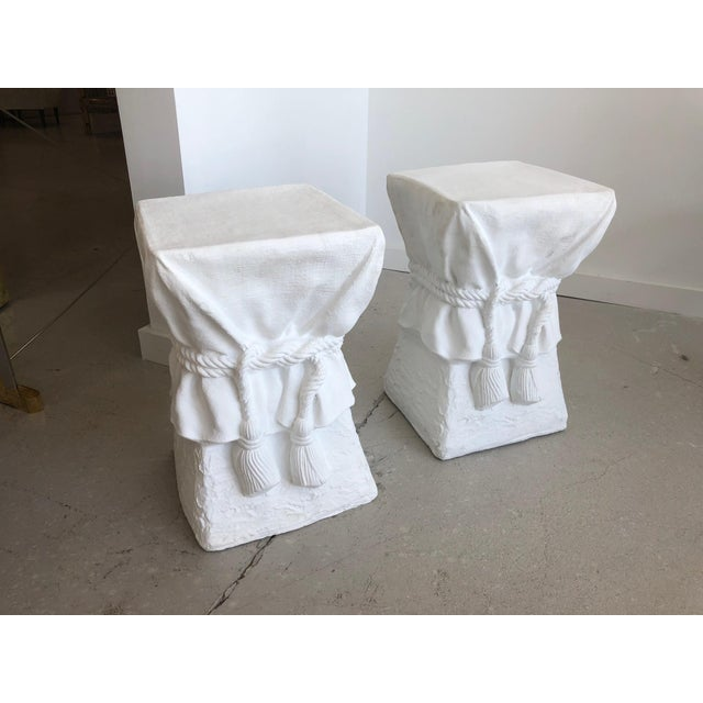 Pair of white plaster composition stools with rope motif in the style of John Dickinson . We have 2 pair available.