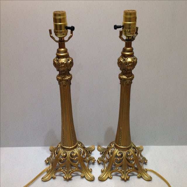 Offered is a vintage 1970's cast metal lamps painted in gold with an antique finish. Made by Loevsky & Loevsky Co. Harps...