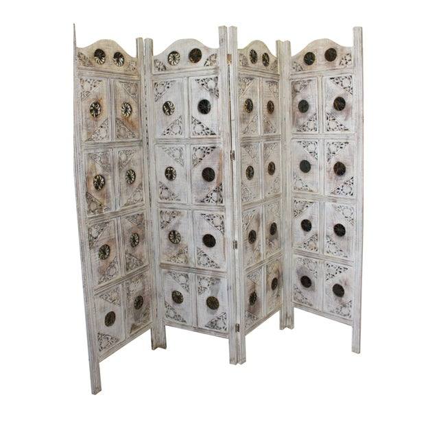 The screen has four panels solid wood painted in a white antique rustic finish. Handmade/handcarved room divider/screen....