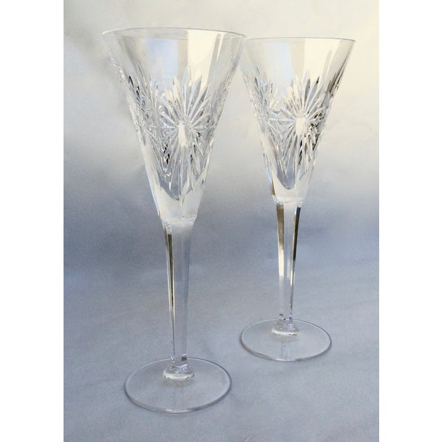"Pair of Waterford crystal champagne flutes. ""Health"" from the Millennium Series."