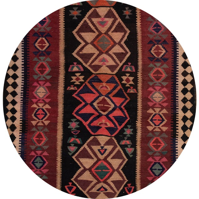 A beautiful hand-woven vintage Kilim runner with a red field, and multi-color accents an all-over geometric design. This...