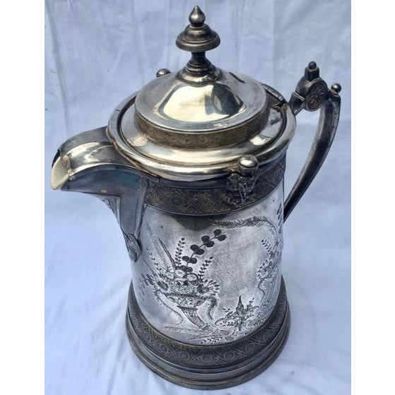 Crafted in the 1870s, this antique Victorian Reed & Barton silver-plated tankard is stunning! Reed & Barton has always...