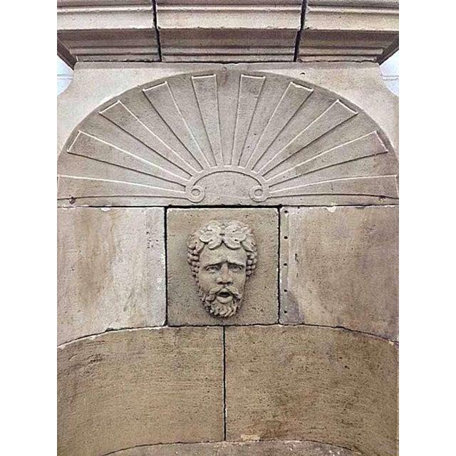 Tall antique wall fountain with base. Bacchus face as center decor.