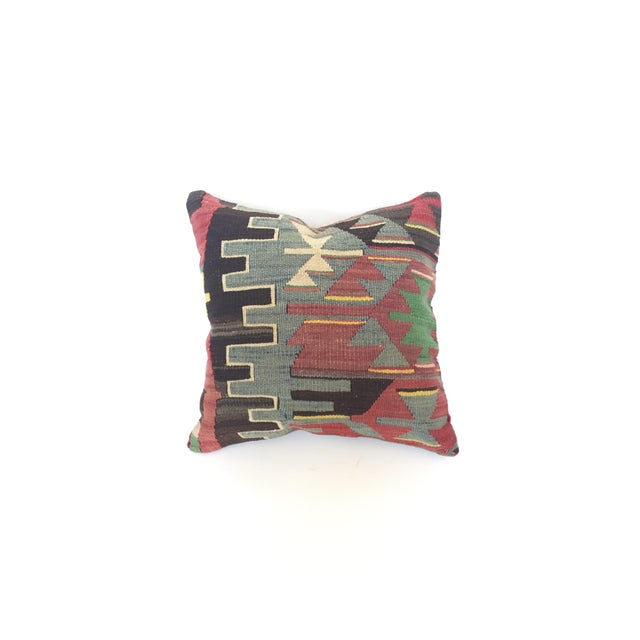A beautiful, one of a kind, square pillowcase created from pieces of vintage Turkish kilim rug remnants. The kilim has...