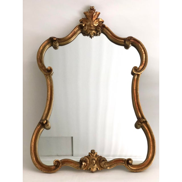 Stunning gilt mirror with carved detail.