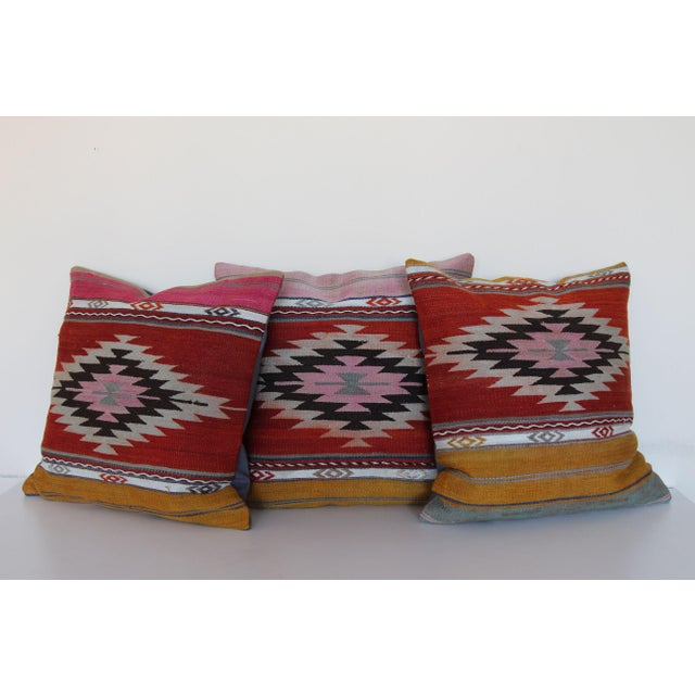 "A set of 3 kilim rug pillows measures 18"" W x 18"" L each and hand-knotted along the Mediterranean & Aegean coast of..."