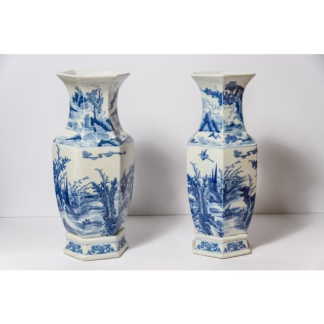 Great pair of 20th C. Tall Chinese Blue & White Porcelain Vases in a hexagonal shape. Beautifully hand painted and marks...