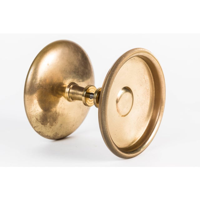 Set of two heavy Italian brass doorknobs that can be mounted back to back as shown or surface mounted side by side.