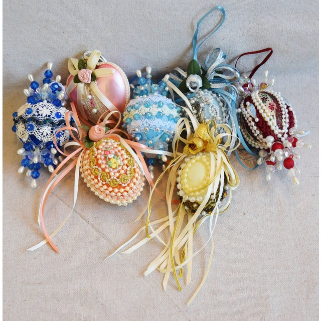 """Set of 7 vintage hand-decorated Christmas tree ornaments. No maker's mark. Ornaments, 3""""Dia x 5""""H."""