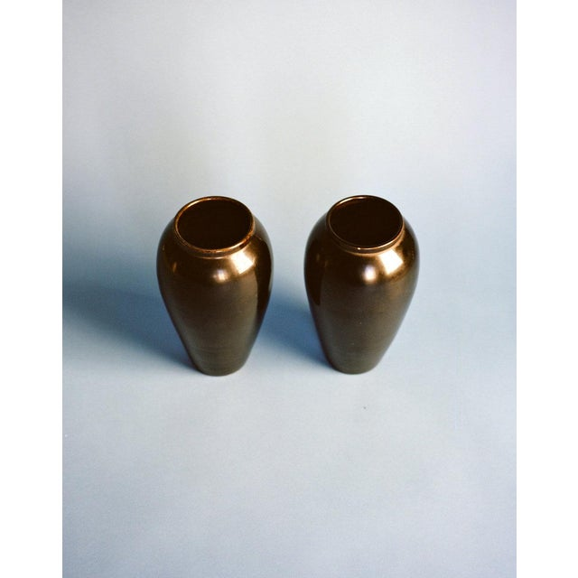 """A pair of black glazed vases produced in Vallauris, France in the late 1930s. Each vase is signed """"Gaziello Vallauris""""..."""
