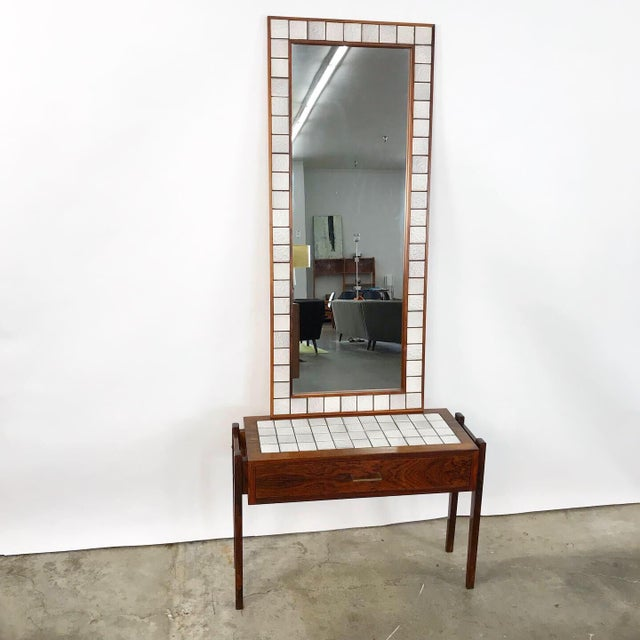 Dress up your bedroom with this enchanting Danish rosewood & tile mirror. The base has a dove tailed drawer and brass...