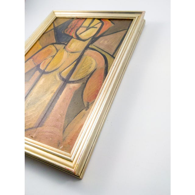 French oil on board in vintage European frame. A magnificent cubist depiction of a shapely young woman in muted hues....