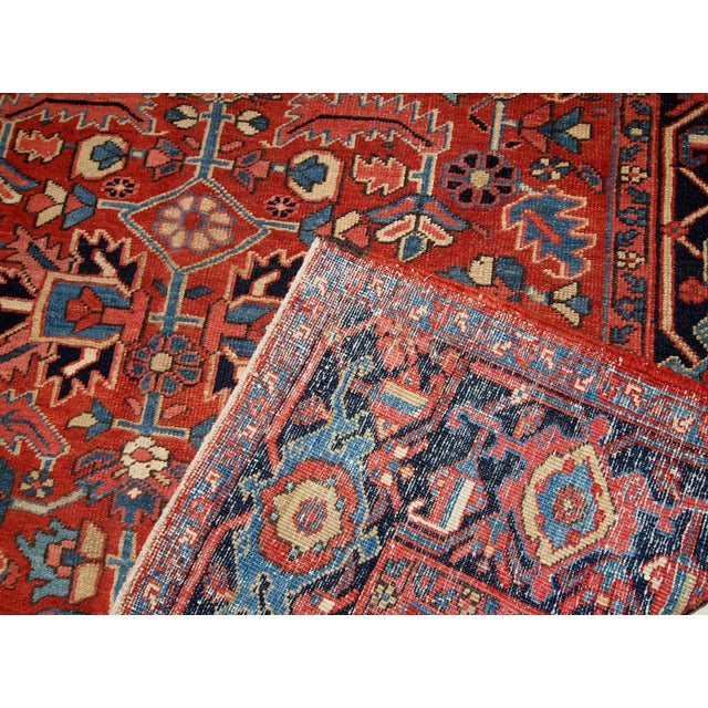 Handmade Middle-Eastern rug in red wool. It is in original good condition from the beginning of 20th century.