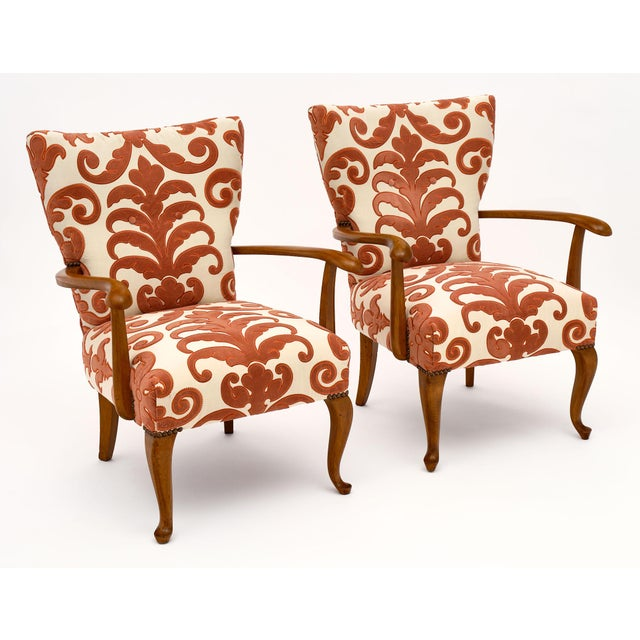 Mid-century French vintage armchairs made of walnut and featuring the original fabric. We love the unique design and...