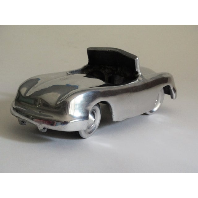 Fabulous stylized 1950's chrome convertible roadster. This retro American model is a perfect collectible for a car...
