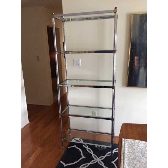 Vintage chrome shelf unit with 5 glass shelves. Each shelf is held flush too frame by 10 nylon pins. Attributed to Maison...