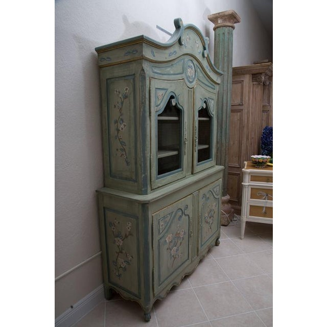 "This is a charming custom later buffet de corps with an arched cornice and two cupboard doors inset with ""chicken"" wire...."
