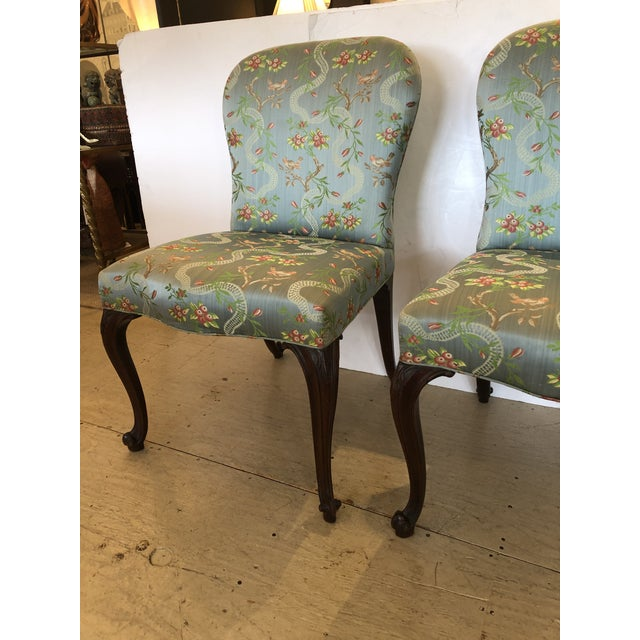 Superbly elegant pair of Georgian 18th century side chairs having mahogany cabriole legs terminating in snail shaped feet,...