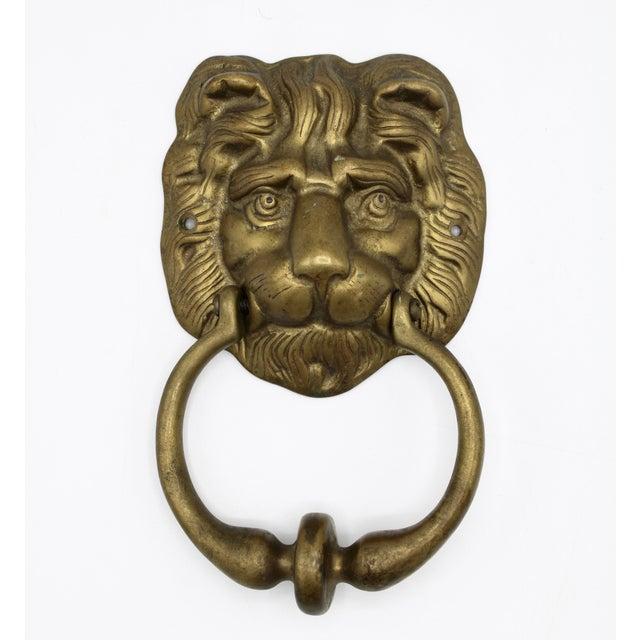 A stunning Vintage Lion's Head Door Knocker. This solid brass lion door knocker is a classic, timeless doorway decoration....