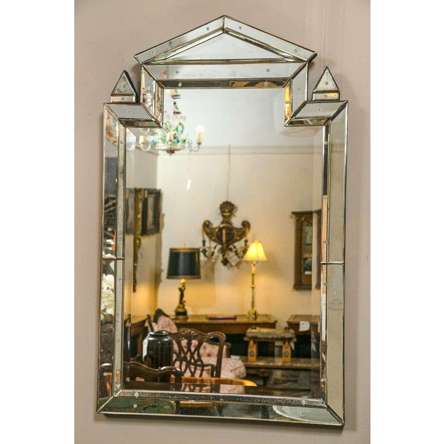 Pair of Piedmont Hollywood Regency style mirrors. The central beveled mirror framed in an all-over distressed antiqued...