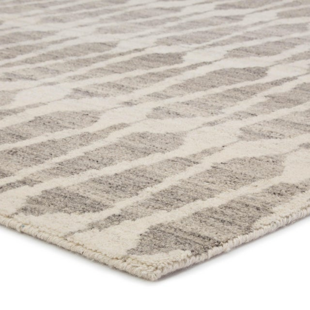 The azland collection highlights the stunning artisan-made quality of a Persian knot accent. The sabot hand-knotted area...