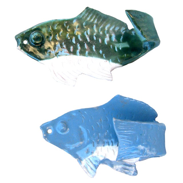 """Whimsical wall mounted """"fish hooks"""" in mottled green, sky blue, & white glazes on white pottery figures. Perfect to hang..."""