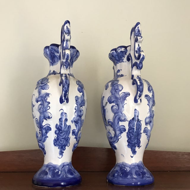 Listing is for an attractive pair of blue and white run shaped vases. I think they would look terrific on a mantle or...