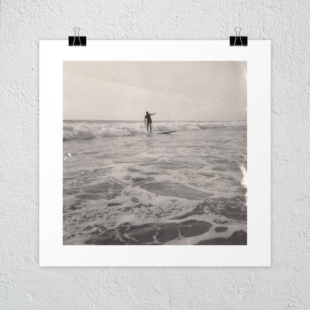 This dreamy, vintage photo of a surfer will look good on nearly any wall. Unframed photography print on heavyweight,...