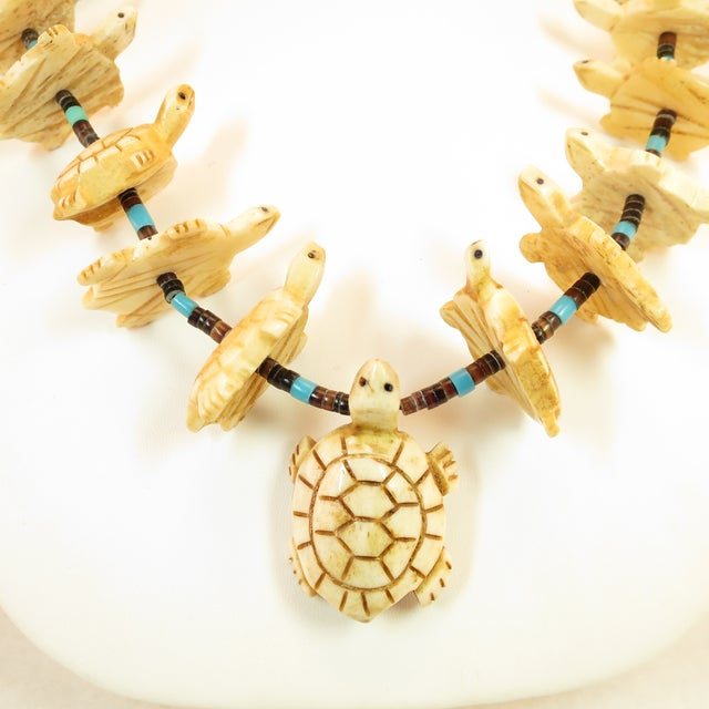 Offered here is a Native American Zuni handcrafted fetish necklace from the 1970s. Rows of graduated horizontally-set bone...