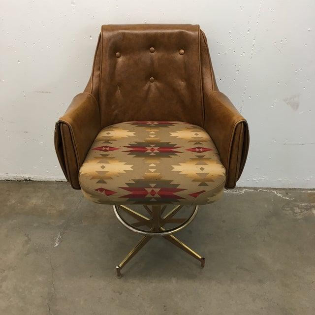 Danish-modern bar stool intricately upholstered with tufted naugahyde luxurious padding on height adjustable atomic...