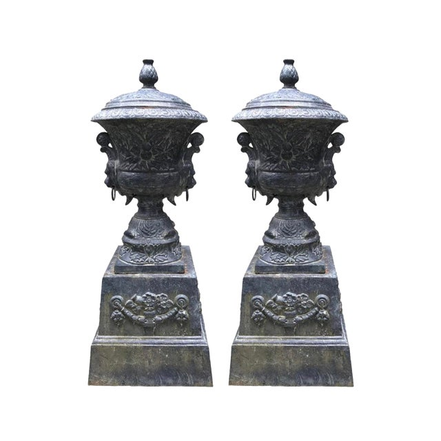 Monumental Antique Covered Cast Iron Urns on Plinths and Lion Head Handles, Pair For Sale
