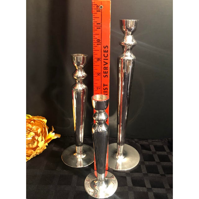 These lovely set of candle sticks are very heavy metal weighing in at just over 8.5 lbs! I believe the silver plate is...