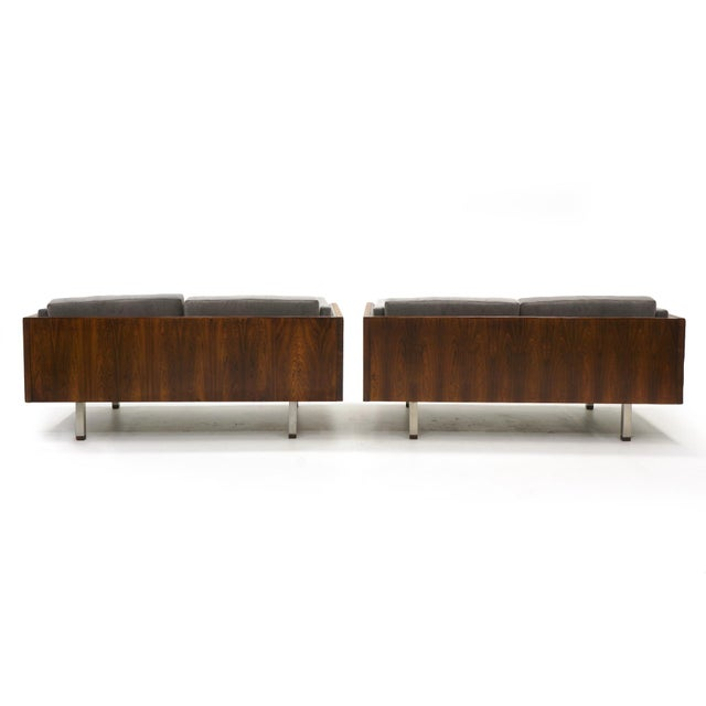 Stunning seating group in Brazilian rosewood by Jydsk Mobelvaerk, Denmark. Two loveseats and one lounge chair. Case design...