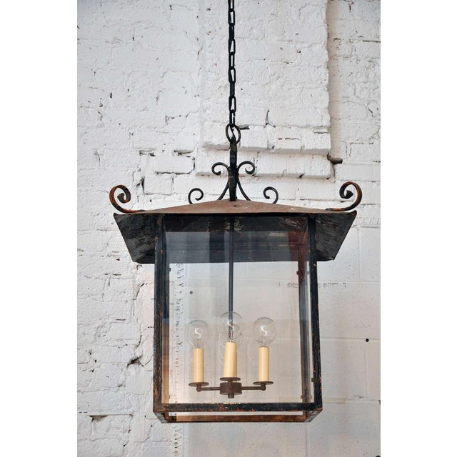 ****ONLY ONE AVAILABLE**** Large metal and glass continental lantern with curling finials in the mid-late 20th century...