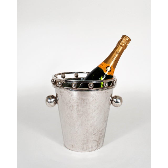 "Glam champagne / ice bucket by Larry Laslo with beautiful patina. The opening is 8"" wide and the base measures 5"" wide"