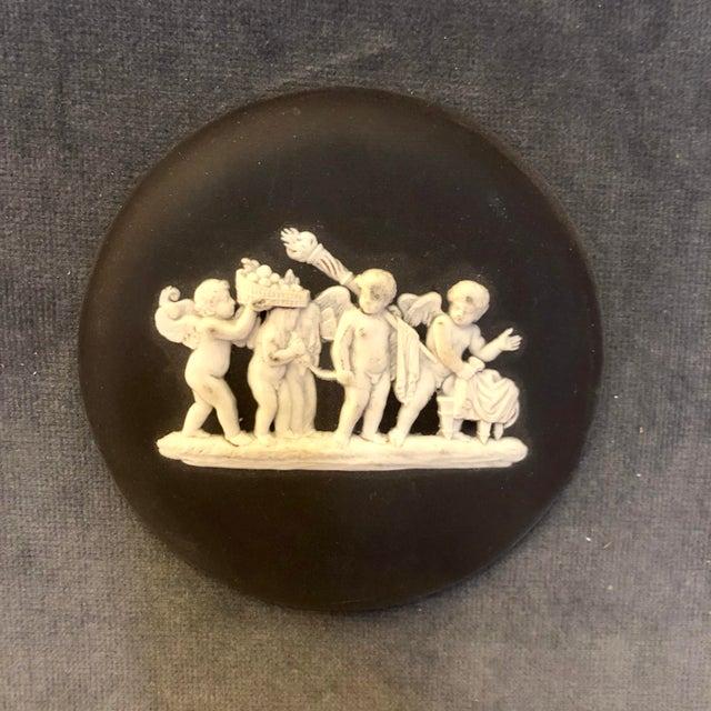 Vintage framed Wedgwood black jasperware plaque.